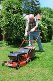 Man with lawn mower Royalty Free Stock Photos