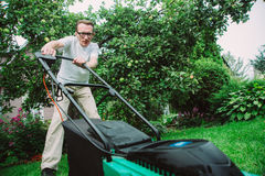 Man with lawn mower Royalty Free Stock Images