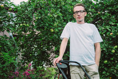 Man with lawn mower Stock Photography