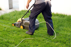 Man with a lawn mower Royalty Free Stock Image