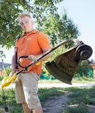 Man with a lawn mower Stock Photos