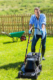 Man lawn mowing Stock Images