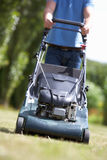 Man with lawnmower Royalty Free Stock Photos