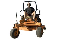 Man on lawnmower isolated. A man riding a large landscaping piece of equipment. Isolated over white royalty free stock images