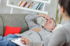 Man layed on couch talking to therapist. Therapist stock photos