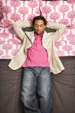 Man laying on bed. Royalty Free Stock Images