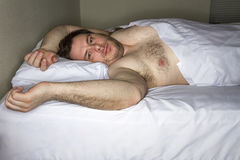 man laying in bed Stock Image