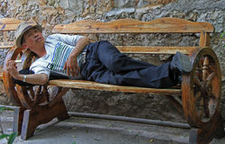 Man is laying on the bench in Lijiang, China Stock Images
