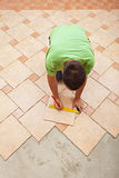 Man laying ceramic floor tiles Royalty Free Stock Photography