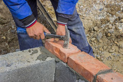 Man laying concrete block and bricks wall Royalty Free Stock Images