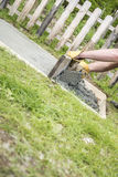 Man laying a concrete slab in the garden Stock Image