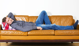 Man laying on couch Royalty Free Stock Photo