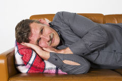 Man laying on couch Royalty Free Stock Images