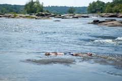 Man Laying Down In River stock image