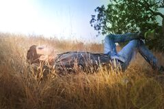 Man laying in field Stock Photos