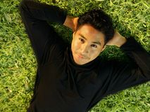 Man Laying On Grass Stock Photography