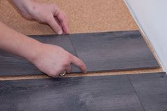 Man laying laminate flooring in a home Stock Images