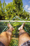 Man laying in hammock on a summer day Stock Images