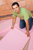 Laying insulation layer on the floor Stock Photo
