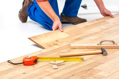 Man laying laminate flooring Royalty Free Stock Photography