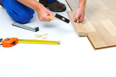 Man laying laminate flooring Royalty Free Stock Photos