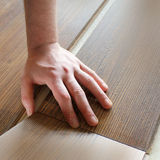 Man laying laminate flooring Royalty Free Stock Images