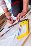 The man laying laminate flooring in construction concept Stock Images