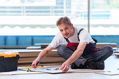 The man laying laminate flooring in construction concept Royalty Free Stock Image