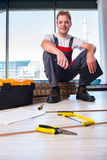The man laying laminate flooring in construction concept Stock Photography