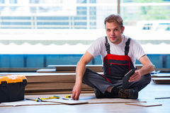 The man laying laminate flooring in construction concept Royalty Free Stock Photography