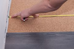 Man laying laminate flooring in a home Stock Photo