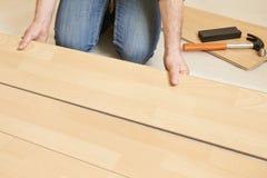 Man Laying Laminate Flooring Stock Image
