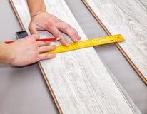 Man laying laminate flooring Royalty Free Stock Photos