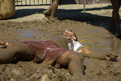 Man laying in the mud Royalty Free Stock Photography