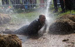 Man laying in the mud, squirted with water Royalty Free Stock Photo