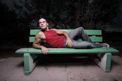 Man Laying On A Bench Stock Photography