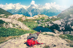 Man laying relaxing with backpack on rocks Stock Photography