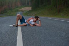Man laying on the road Royalty Free Stock Photos