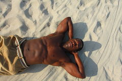Man laying on the sand Stock Photography