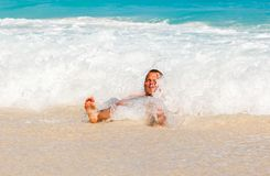 Man laying on sandy beautiful tropical beach Stock Images
