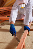 Man laying thermal insulation layer on building Stock Photos