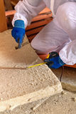 Man laying thermal insulation layer - closeup Stock Photos