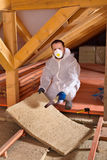 Man laying thermal insulation layer Royalty Free Stock Photography