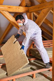 Man laying thermal insulation layer Royalty Free Stock Images