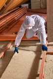 Man laying thermal insulation layer - wearing protective clothin Royalty Free Stock Photos