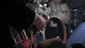 Man lead guitarist playing electrical guitar stock video footage