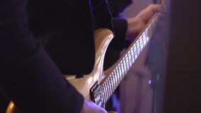Man lead guitarist playing electrical guitar on concert stage slow motion.  stock video footage