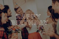 Man Leads Woman to Surprise Party. Happy Birthday. royalty free stock photography