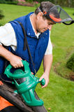Man with leaf blower. Senior man with leaf blower royalty free stock image
