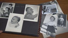 Leafing through a vintage photo album FDV